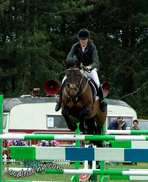 Competing in show jumping competitions